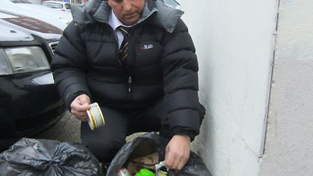 Cllr Barry Tebbutt marks up abandoned waste in Romford town centre