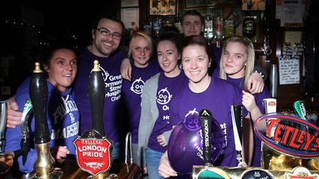 Dale Hayes and Claire Bowler with the Boleyn Tavern's staff as they raise money for Great Osmond Str