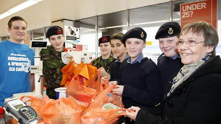 The cadets helped customers in exchange for donations. Picture: Sandra Rowse