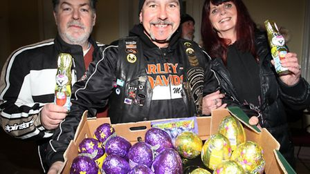 Essex Chapter bikers Chris Ruse,left, Gaz and Fran Driver donate Easter eggs to Community Links char