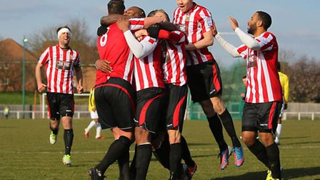 Kieron St Aimie scores the winning goal for Hornchurch and celebrates with team mates (Gavin Ellis/T