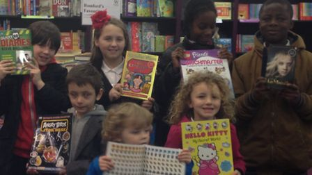 Children from Broadford Primary School pick out their favourite books to mark World Book Day.
