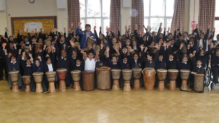 Gearies Junior School learning how to play the African drums.