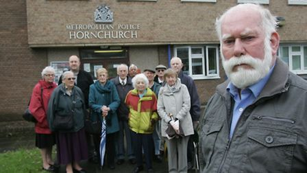 Cllr John Mylod with local residents & cllrs outside Hornchurch police station last year when a peti