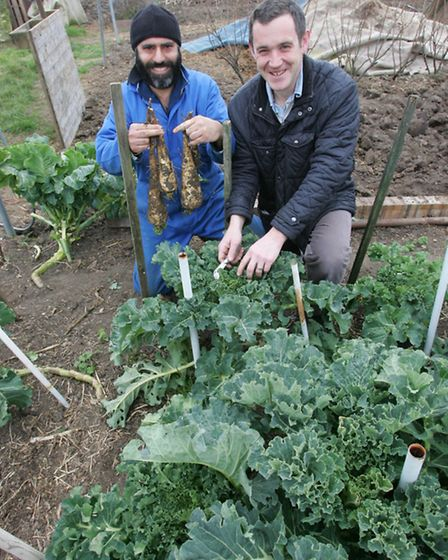 Manjit Bains and James Green with some of their vegetables