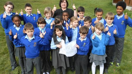 Headteacher Beverly Swain with children from Harold Court Primary School celebrate their good Ofsted