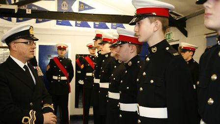 DAO Lt Cdr Cliff Lewis RNR SCC inspects the ship's company of the TS Hurricane Hornchurch and Upmins
