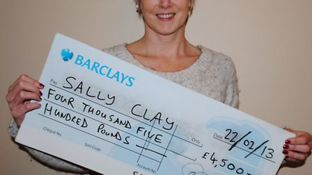 Sally Clay with the £4,500 cheque