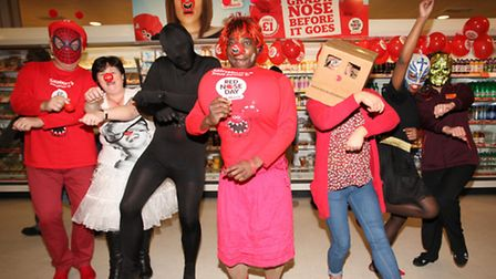 Staff from Sainsbury's in Stratford Centre amuse shoppers with their Gangnam Style dance on Red Nose