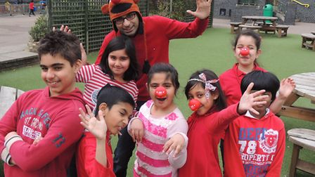 Staff sponsored Kulvarn Atwal, headteacher, to wear a very warm funny hat for the day