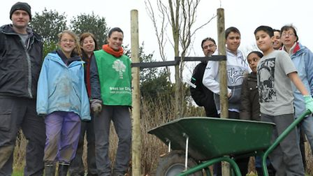 Trees for cities joins in with friends of the Park to plant trees in South Park, Ilford. Members of