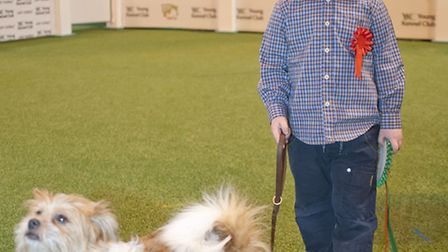 Nicholas Skidmore, four, won the Shaun McAlpine Outstanding Young Person Award at Crufts. Pictured w