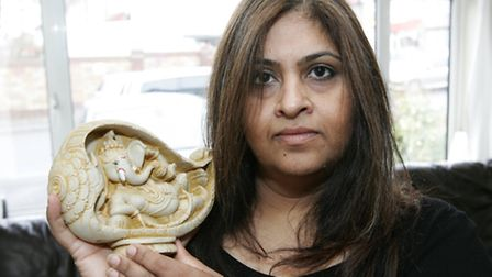 Varsha Mistry with an image of Lord Ganesh