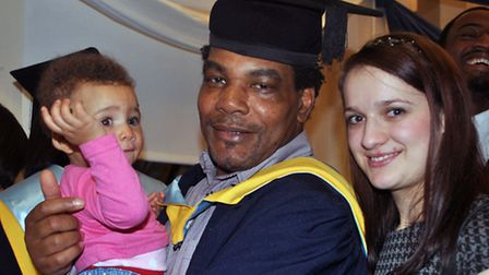 Graduate Carlton Gabbidon with his partner, Alina, and their baby at the ceremony