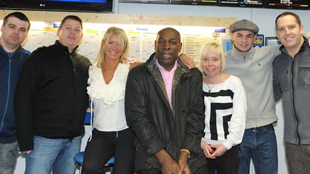 Heavyweight Boxing champion Frank Bruno (centre) with Nicola Harrison (third from left) and customer