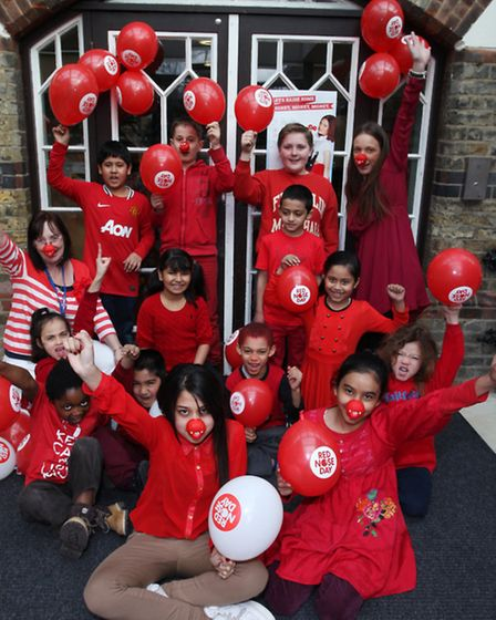 St Paul's Primary schoolchildren and staff get on the Red Nose Day spirit.