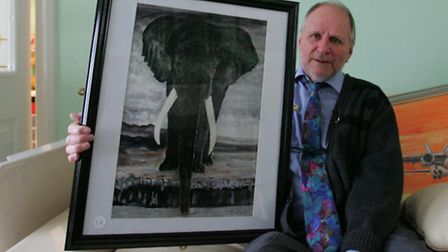 William Starling with some of his paintings
