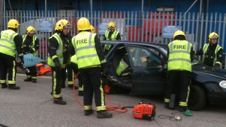 """Firefighters from the three stations rescue two """"car crash victims"""" during a training exercise"""