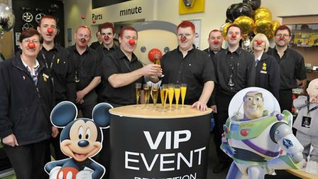 Staff at Renault Romford raise money for Red Nose Day in 2011. From left: Kim Brett, David Coles, An