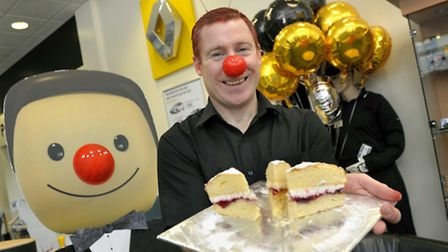Renault Romford sales manager Neil Grottick with cakes baked to raise money for Red Nose Day in 2011