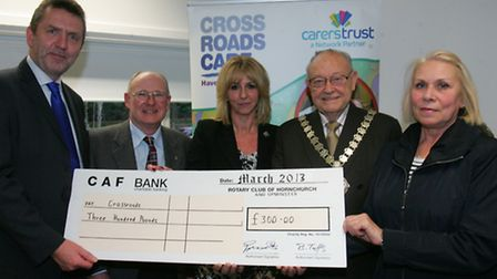 Crossroads receives a cheque from the Rotary club; Andy Palmer (chairman of Crossroads Care Havering