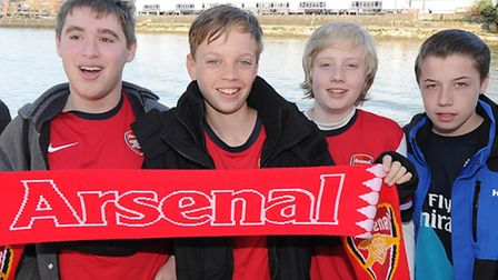 David Saunders (left) enjoys a boat trip with other Arsenal fans