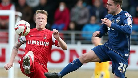Os Nathan Clarke and Oldhams Jose Baxter clash at the Matchroom Stadium on Saturday