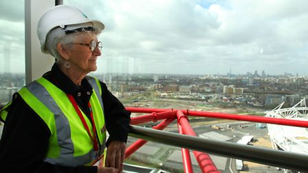 Josephine Roberts looks at the views from the observatory deck at the ArcelolMittal Orbit tower in t