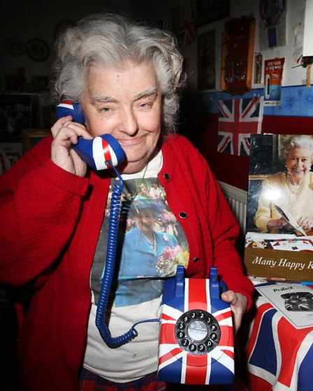 Royalist Lil Forkner poses a phone call to Her Majesty the Queen on her 87th birthday.