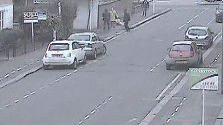 CCTV images showing woman having her necklace snatched from around her neck. CCTV images sent in by