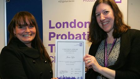 Jane receives her award from assistant chief officer Lucy Satchell-Day