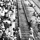Refugees throng platform and railway lines as they await trains to leave Pakistan after widespread r