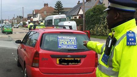Picture shows PCSO Wupundu Simpungwe with a seized vehicle.