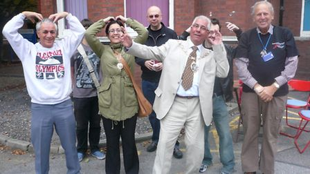 Cllr Muhammed Javed, the Mayor of Redbridge, adopts Usain Bolt's pose while fellow charity walkers f