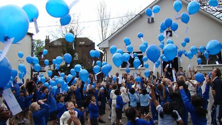 Children at Avon House Preparatory School release balloons into the sky for Haven House Children's H