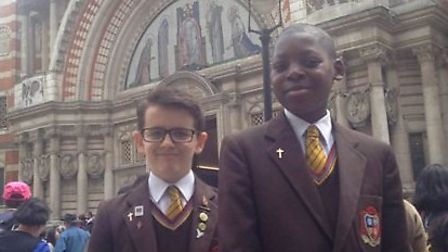 Year Seven student Jamie Halliwell and Year Eight pupil Hendrix Miayoukou outside Westminster Cathed