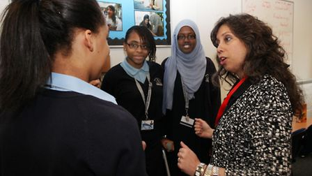NASA scientist Nagin Cox with Sarah Bonnell's Headteacher Sarah Jacobs, left, and students.