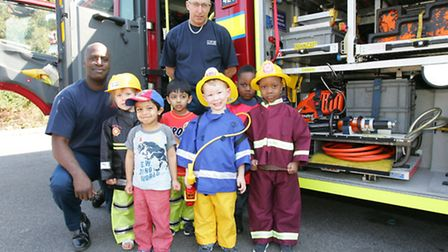 Firefighters from Ilford station visiting the Busy Bees nursery to talk to children, and show them t