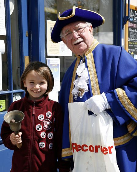 Erin Walker (eight) with town crier Harry Matthews during Friday's Shop Local campaign (photo: Sandr