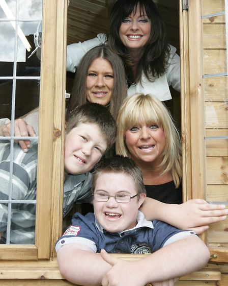 Thomas Lee, 14, front, was the 150th child to be granted his wish. He is pictured with, from top, ac