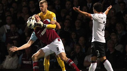 Manchester United goalkeeper David De Gea (centre) catches the ball ahead of West Ham United's Andy