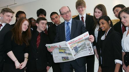 BBC political editor Nick Robinson reads the Recorder with Palmer Catholic Academy pupils