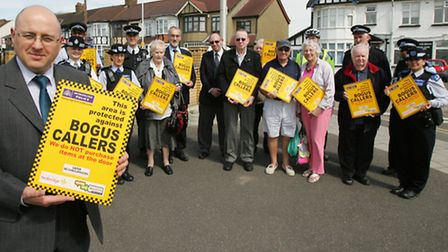 Redbridge Council leader Cllr Keith Prince (front) with Safer Neighbourhood Team officers, Neighbour