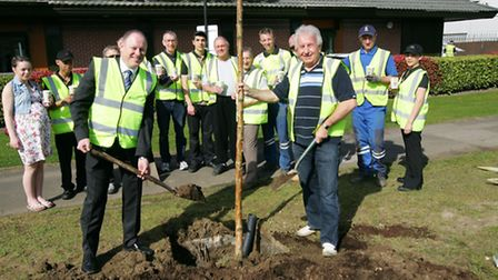 Cllr Brian Eagling and residents landscape an area of land outside McDonald's in Bryant Avenue, Haro