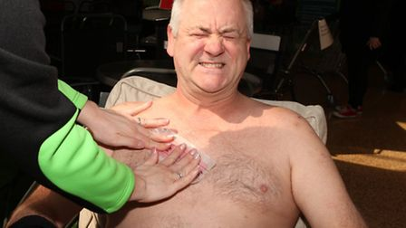 Andy Mitson gets his legs waxed to raise money for a breast cancer charity in a fundraising event at