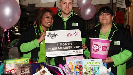 ASDA staff Afsana,left, Ian and Michelle raise money for a breast cancer charity in a fundraising e