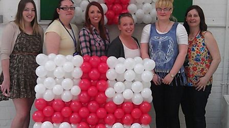 Level Two students at Newham College with their St George's flag made out of balloons.
