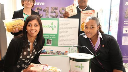 Halifax staff and Newham Foodbank charity present a new food deposit point at the bank branch in Hi