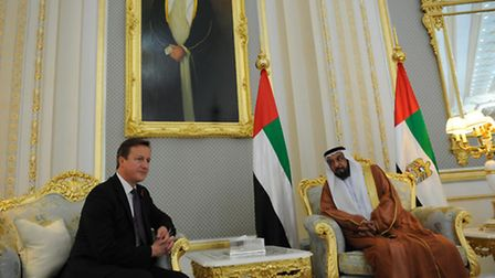 Prime Minister David Cameron is welcomed to the Al Rawda Palace in the city of al Ain in Abu Dhabi b