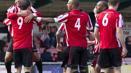 Hornchurch players celebrate the first goal scored by Martin Tuohy (9) against Hayes (Ray Lawrence/T